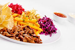 A Tasty food. Grilled meat with French fries. High quality imag Royalty Free Stock Image