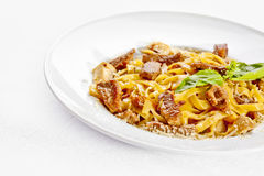 Tasty food. Pasta with roasted meat. Stock Photo
