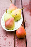 Tasty fragrant pear lying on a  plate Royalty Free Stock Image