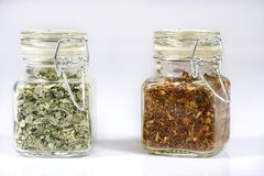 Tasty fragrant spices in jars. Pantry with spices. White backgro Royalty Free Stock Images