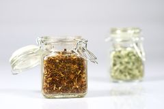 Tasty fragrant spices in jars. Pantry with spices. White backgro Stock Photography