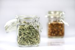 Tasty fragrant spices in jars. Pantry with spices. White backgro Stock Photos