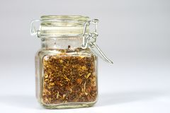 Tasty fragrant spices in jars. Pantry with spices. White backgro Stock Photo