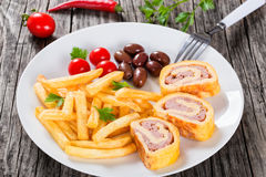 Tasty french fries with baked cheese meat Roll-Ups Royalty Free Stock Image