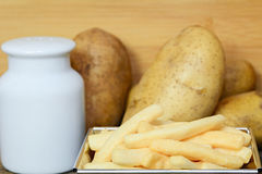 Tasty french fries in metal plate. On table Stock Photography