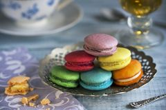 Tasty french macarons on a wooden table with vintage color tone, royalty free stock photos