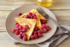 Tasty French toast with fresh raspberries. Sweet food Stock Photography