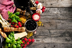 Tasty fresh appetizing italian food ingredients on old rustic wo Stock Photos