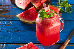 Tasty fresh appetizing watermelon drink smoothie with mint on bl Royalty Free Stock Photography