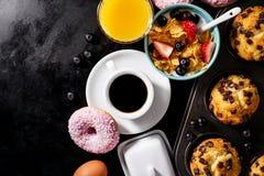 Tasty fresh breakfast food ingredients on black dark background. stock images