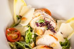Tasty fresh caesar salad with grilled chicken and parmesan Royalty Free Stock Images