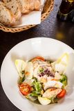 Tasty fresh caesar salad with grilled chicken and parmesan Royalty Free Stock Image