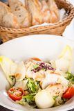 Tasty fresh caesar salad with grilled chicken and parmesan Stock Image