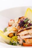 Tasty fresh caesar salad with grilled chicken and parmesan Stock Photos