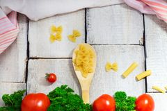 Tasty Fresh Colorful Ingredients for Cooking Pasta Tagliatelle with Fresh Parsley and Tomatoes. Horizontal. Wooden Table Backgroun. D Stock Photography