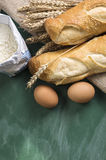 Tasty fresh crunchy bread and raw eggs. Stock Photography