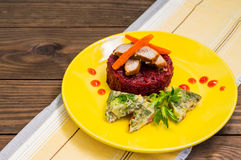 Tasty and fresh dinner with stewed beets, roasted meat, carrots  Spanish omelette. Wooden table. Top view Royalty Free Stock Photography