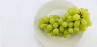 Tasty fresh green grape in a bowl stock images