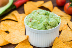 Tasty fresh guacamole with nachos Stock Image