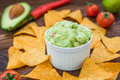 Tasty fresh guacamole with nachos Stock Photos