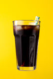 Tasty fresh iced cold black coffee with ice and straw in glass o Stock Photo
