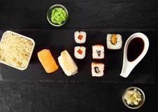 Free Tasty Fresh Japanese Sushi Foods On Black Slate Board Royalty Free Stock Photo - 49987655