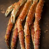 King Crab claw on brown background. Tasty fresh luxury king kamchatka crab`s claw on brown background stock photo
