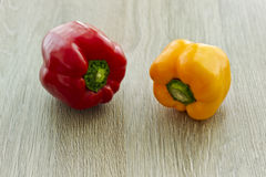 Tasty fresh peppers on a wooden background Stock Image