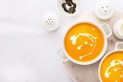 Pumpkin creamy soup decorated with fresh cream royalty free stock images