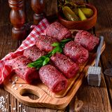 Tasty and fresh raw beef roulades. A tasty and fresh raw beef roulades Stock Photos