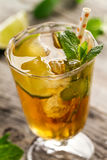 Tasty fresh refreshing summer tea drink with ice, cold tea, lime Royalty Free Stock Images