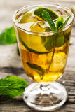 Tasty fresh refreshing summer tea drink with ice, cold tea, lime Royalty Free Stock Image