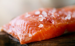 Tasty Fresh Salmon Fish on a Cooking Board on a Kitchen Backgrou Royalty Free Stock Images