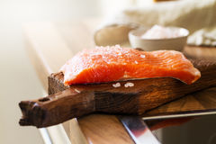 Tasty Fresh Salmon Fish on a Cooking Board on a Kitchen Backgrou Stock Photos