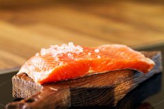 Tasty Fresh Salmon Fish on a Cooking Board on a Kitchen Backgrou Stock Image