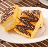 Slice of sponge cake Stock Photos