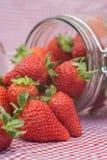 Tasty fresh strawberries in glass storage jar Stock Image