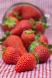 Tasty fresh strawberries in glass storage jar Stock Photos