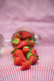 Tasty fresh strawberries in glass storage jar Stock Photo