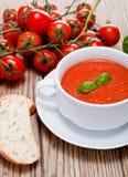 Tasty fresh tomato soup basil and bread Royalty Free Stock Photo