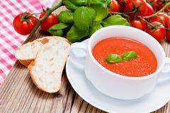 Tasty fresh tomato soup basil and bread Royalty Free Stock Photos