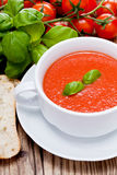 Tasty fresh tomato soup basil and bread Royalty Free Stock Photography