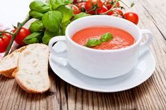 Tasty fresh tomato soup basil and bread Royalty Free Stock Image