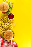 Tasty fresh unhealthy hamburgers with ketchup and vegetables and Stock Image