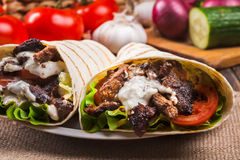 Tasty fresh wrap sandwich with beef and vegetables Stock Images