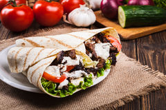 Tasty fresh wrap sandwich with beef and vegetables Royalty Free Stock Images