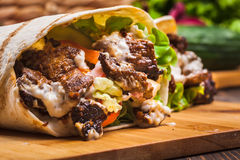 Tasty fresh wrap sandwich with beef and vegetables Stock Image