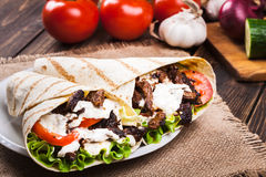 Tasty fresh wrap sandwich with beef and vegetables Royalty Free Stock Image
