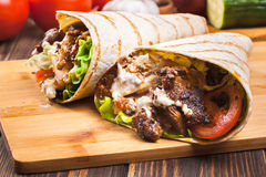 Tasty fresh wrap sandwich with beef and vegetables Stock Photos