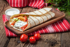 Tasty fresh wrap sandwich. Royalty Free Stock Image